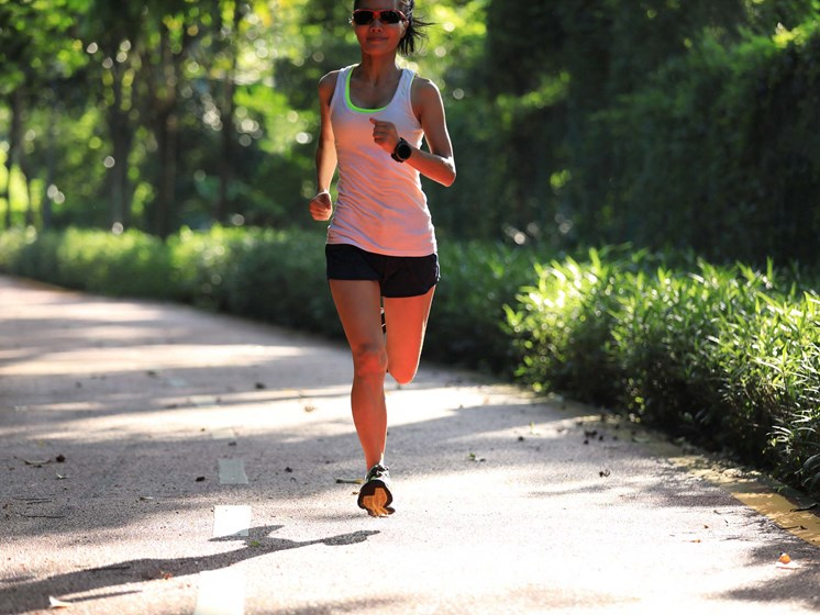 woman jogging on a wooded trail