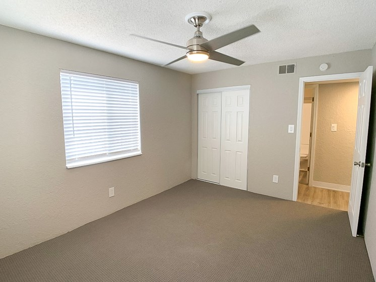 Large bedroom with closet and ceiling fan