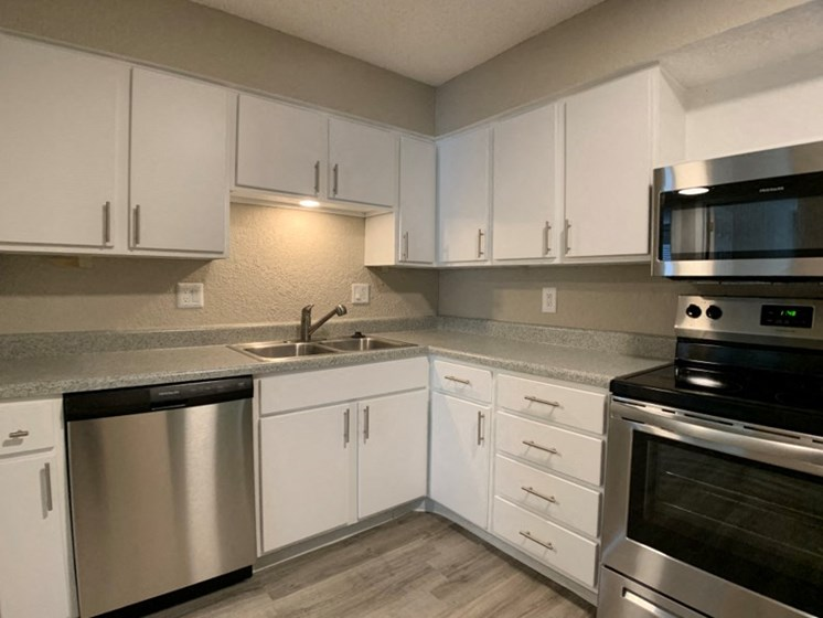 Kitchen with stainless steel appliances and ample storage space