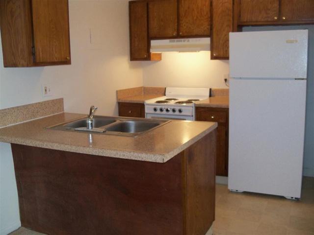 Updated modern kitchens at University Plaza, KC