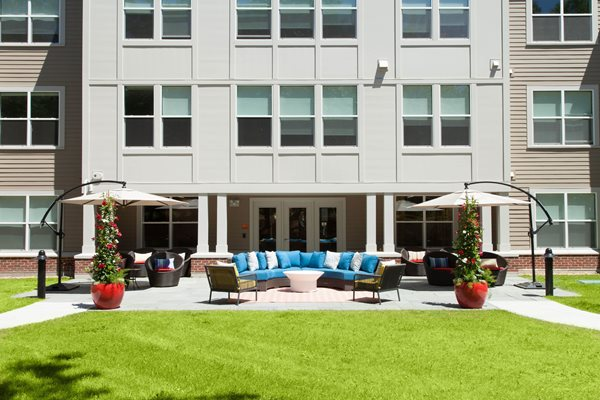 Green Courtyard and Patio with Grills and Outdoor Seating at Linea Cambridge, Cambridge, MA