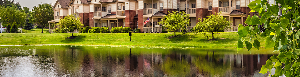 This is a photo of The Sanctuary of Fishers Apartments in Fishers, IN from across a pond
