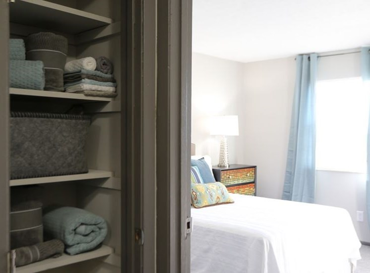 View of extra storage linen closet and bedroom with carpeting and window at Worthington Meadows Townhomes in Columbus, Ohio 43085