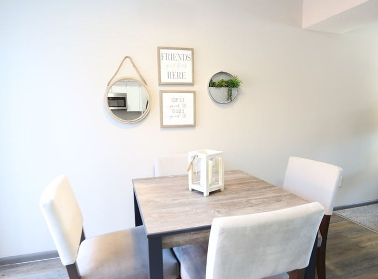 Brightly lit dining room area with hardwood flooring at Worthington Meadows Townhomes in Columbus, Ohio 43085