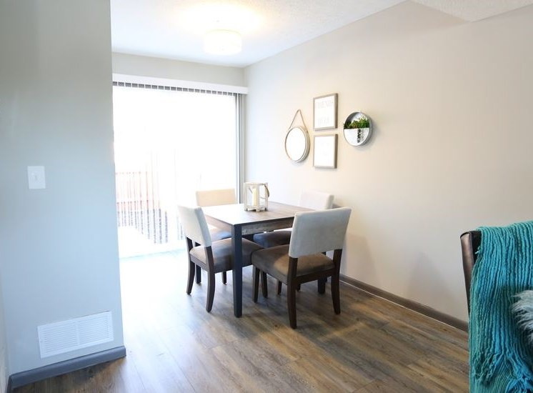 View of dining room area with hardwood flooring at Worthington Meadows Townhomes in Columbus, Ohio 43085