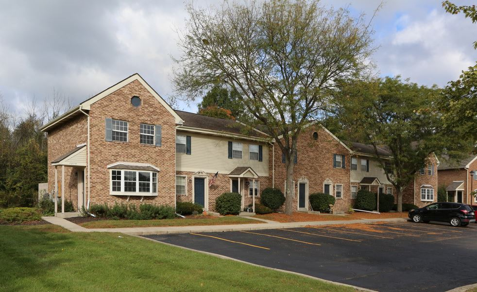 View of parking lot area in front of townhomes at Worthington Meadows Townhomes in Columbus, Ohio 43085