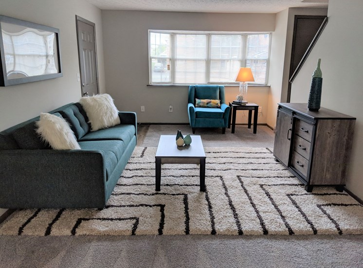 Spacious, bright living room with large bay window, plush carpeting at Worthington Meadows Townhomes in Columbus, Ohio 43085