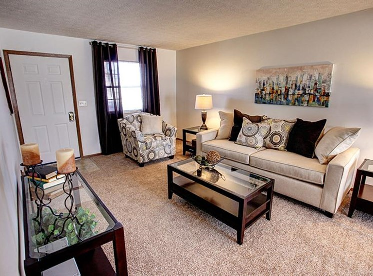 Spacious, bright living room with carpeting and window at Worthington Meadows Townhomes in Columbus, Ohio 43085