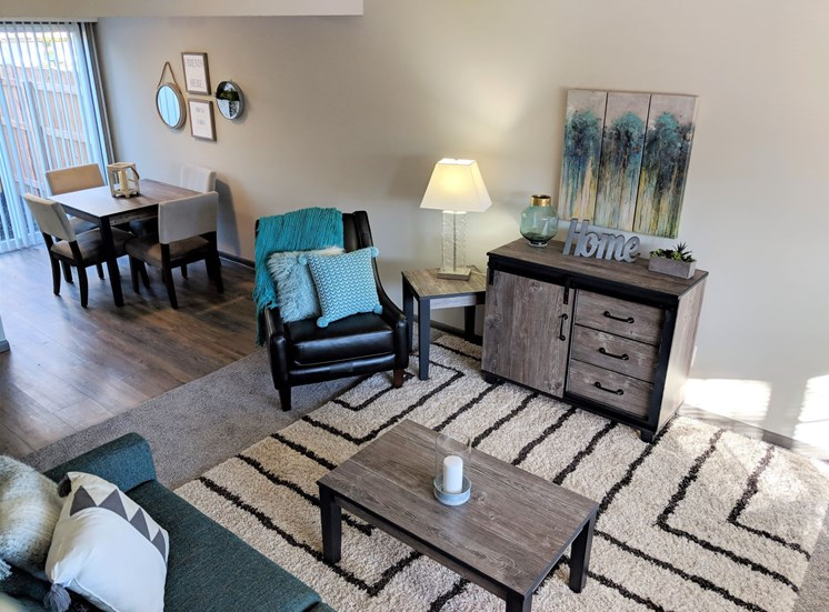 Open floor concept of living and dining areas featuring carpeting and hardwood flooring at Worthington Meadows Townhomes in Columbus, Ohio 43085