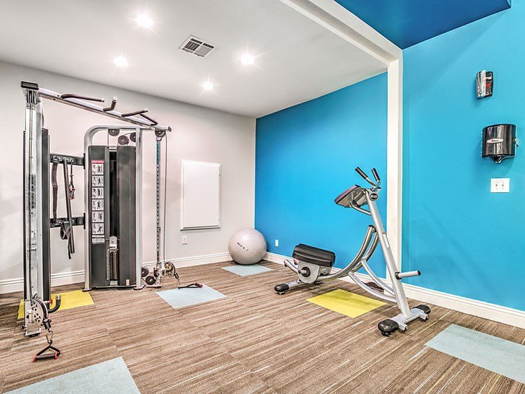 Las Vegas Apartments - St. Lucia Fitness Center With Weight Machines, Exercise Ball, and Floor to Ceiling Mirror