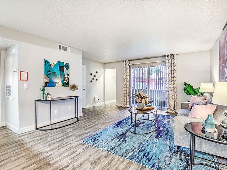 Las Vegas Apartments for Rent - St. Lucia Open Layout Living Room With Access to Dining Area and Kitchen, Hardwood Style Floors, and Stylish Decor