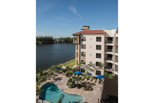 The backyard of the Crystal Riviyera features views of Sailboat Lake, a barbecue area, a pool, and a sun deck.