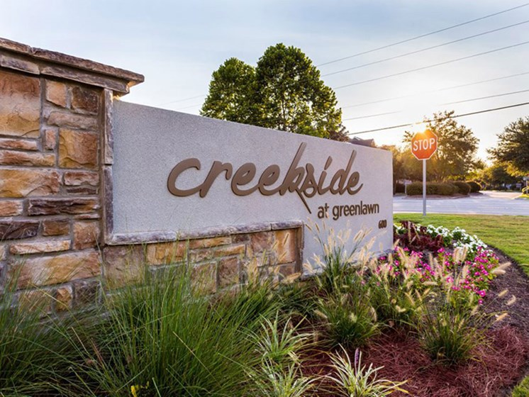 Sign at Front Entrance for Creekside at Greenlawn Apartments in Columbia, SC