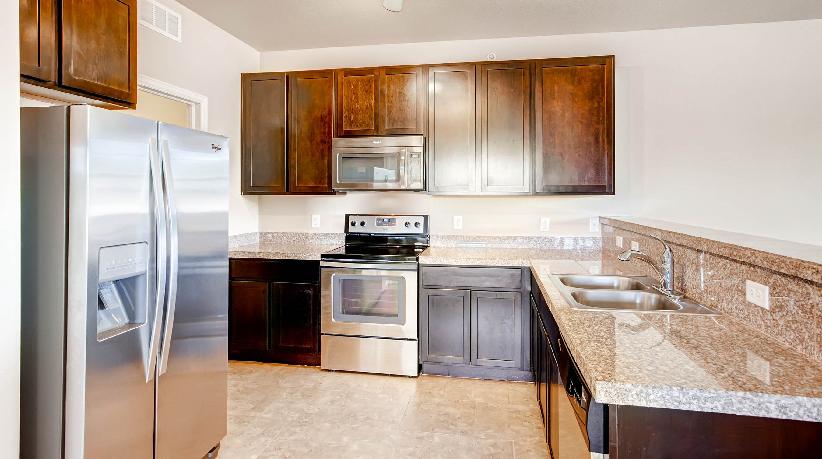 Kitchen at Maple Leaf Apartments in Arvada, CO
