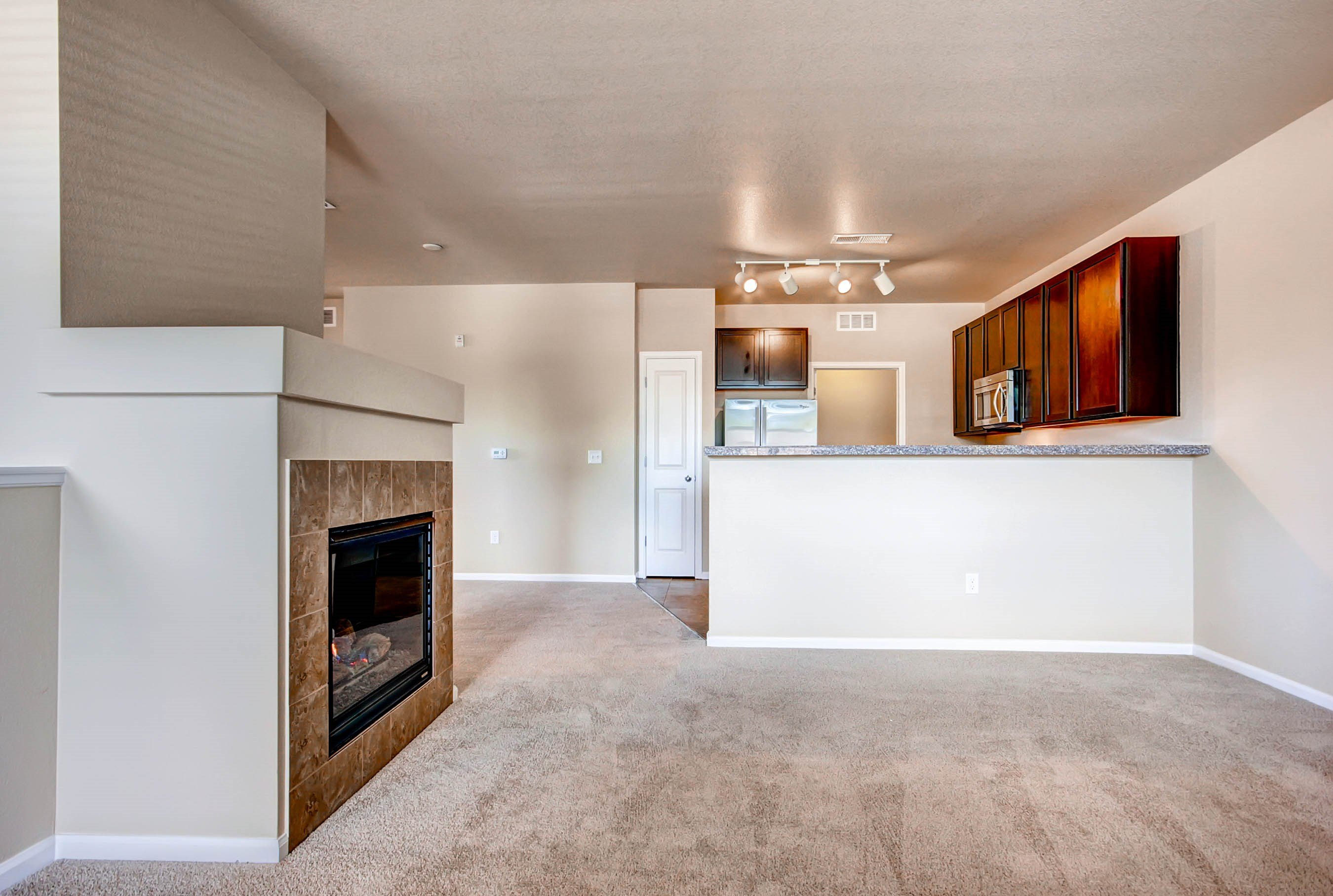 Living Room at Maple Leaf Apartments in Arvada, CO