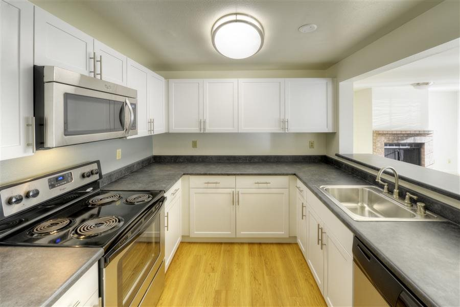 Fully equipped kitchen at Heronfield Apartments, Kirkland, WA,98034