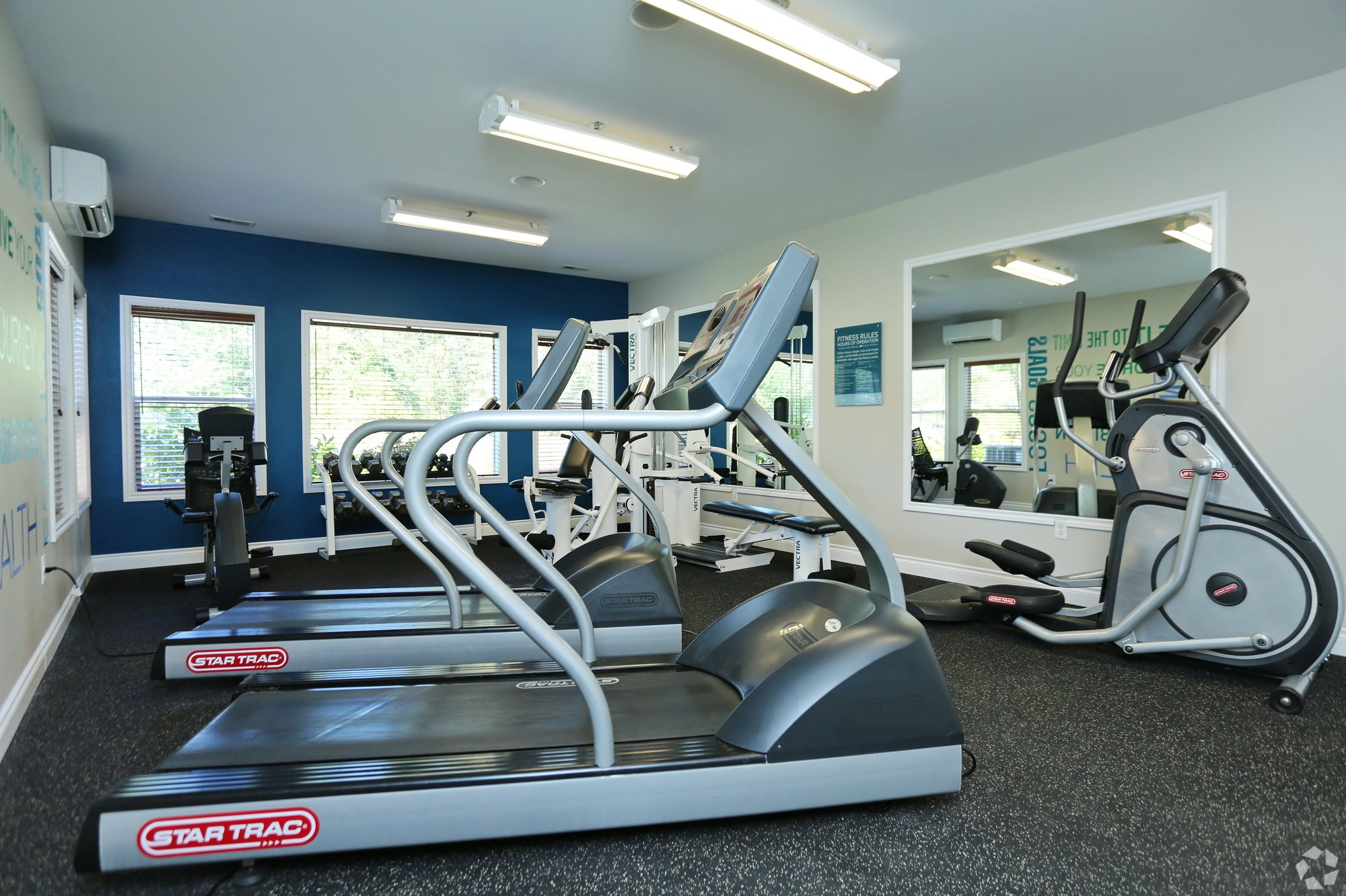 fitness center with treadmills, elliptical machine