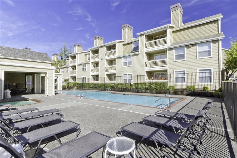 Relaxing pool-side area at Huntington Park Apartments, Everett, WA,98208