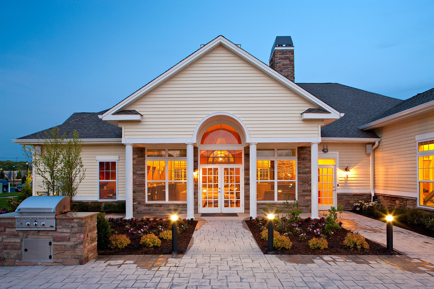 Clubhouse Exterior at Enclave at Charles Pond Apartments in Coram, NY