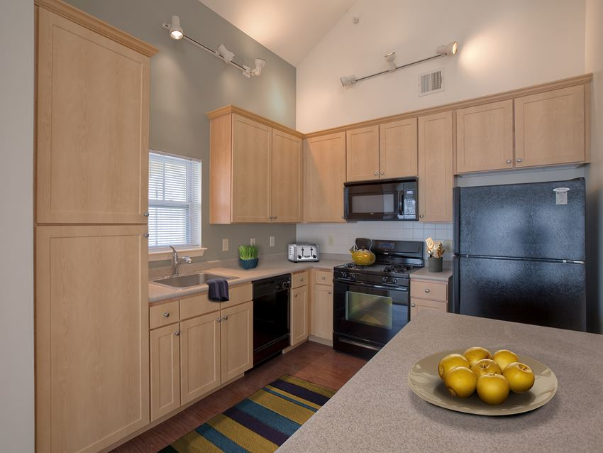 Kitchen at Enclave at Charles Pond Apartments in Coram, NY