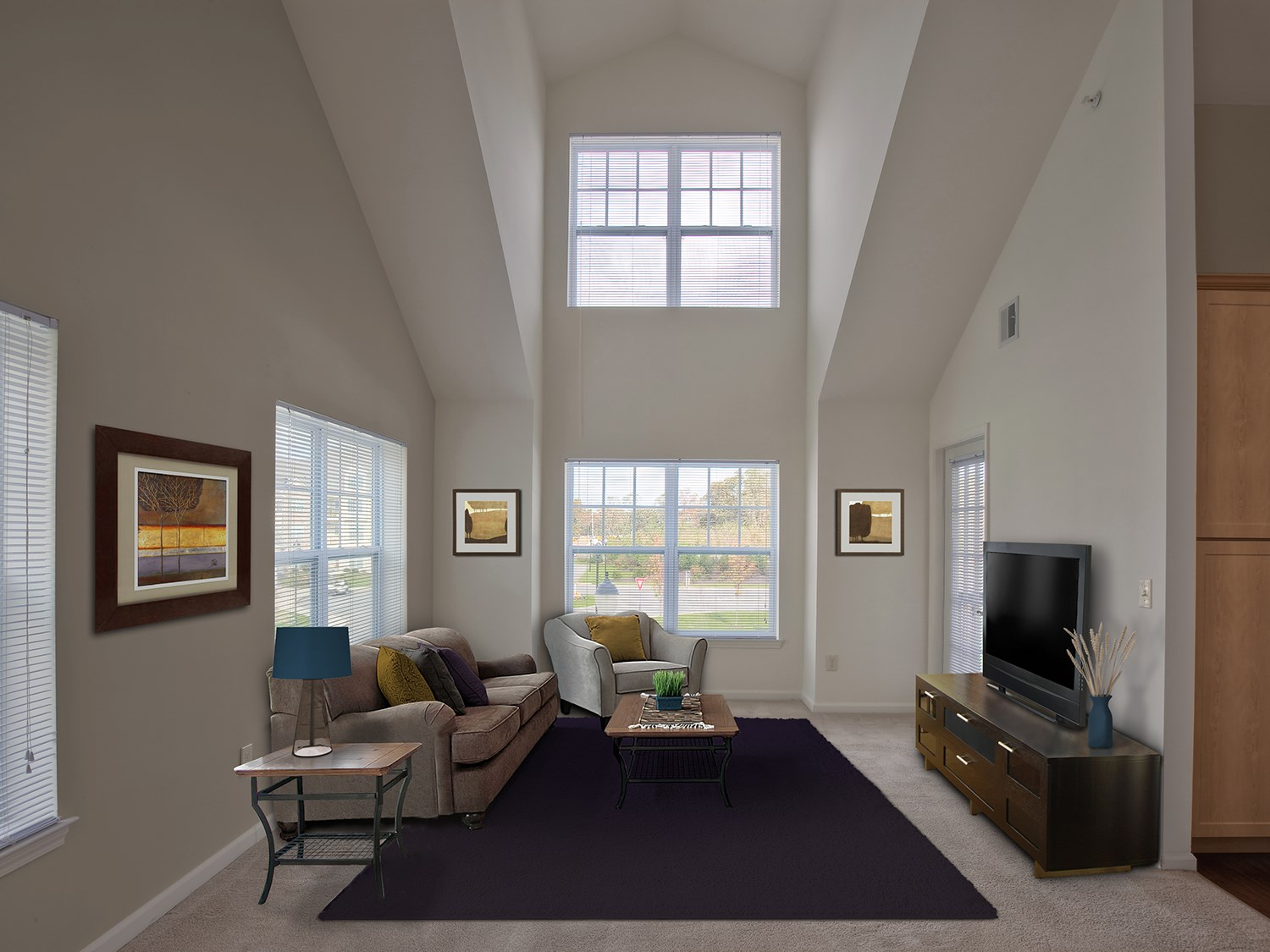 Spacious Livign Room at Enclave at Charles Pond Apartments in Coram, NY