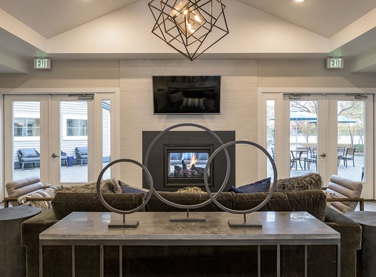Posh Lounge Area With Fireplace In Clubhouse at Edgewater Apartments, Idaho