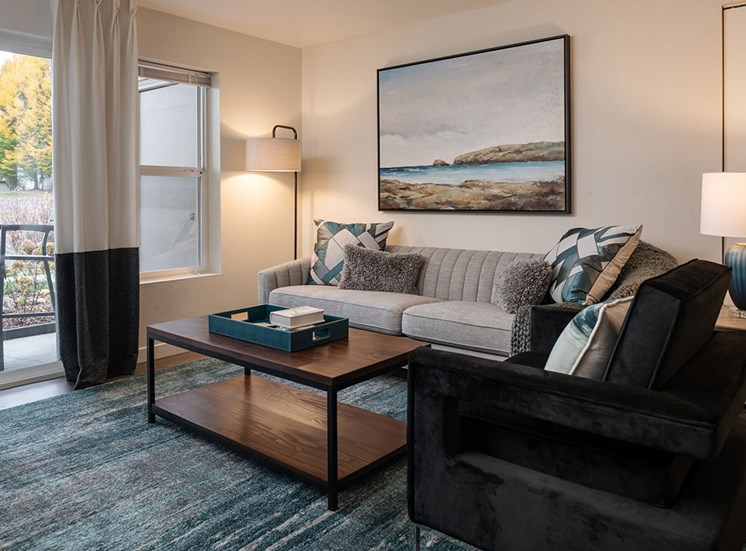 Living Room With Expansive Window at Edgewater Apartments, Boise, ID, 83703