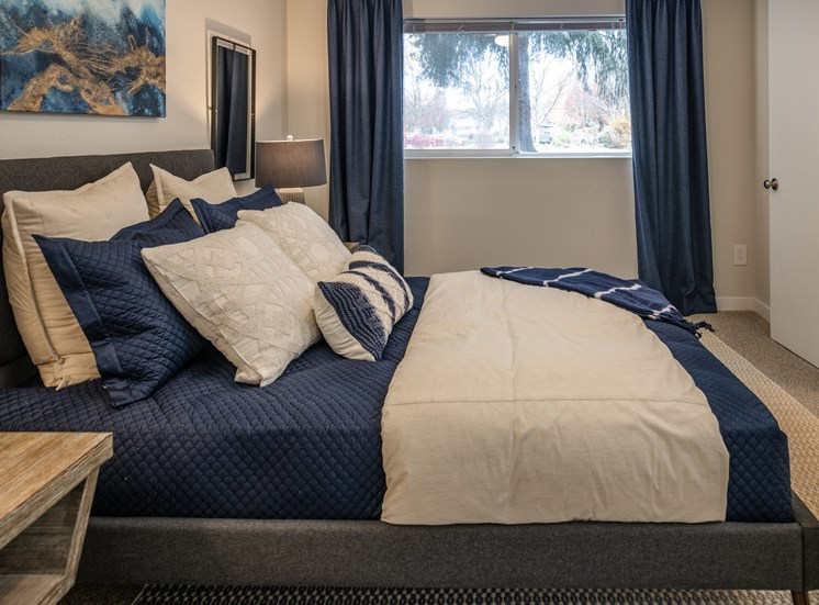 Comfortable Bedroom With Large Window at Edgewater Apartments, Idaho