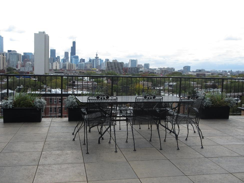 Breathtaking city and lake views, lounge furniture and 2 gas grills!
