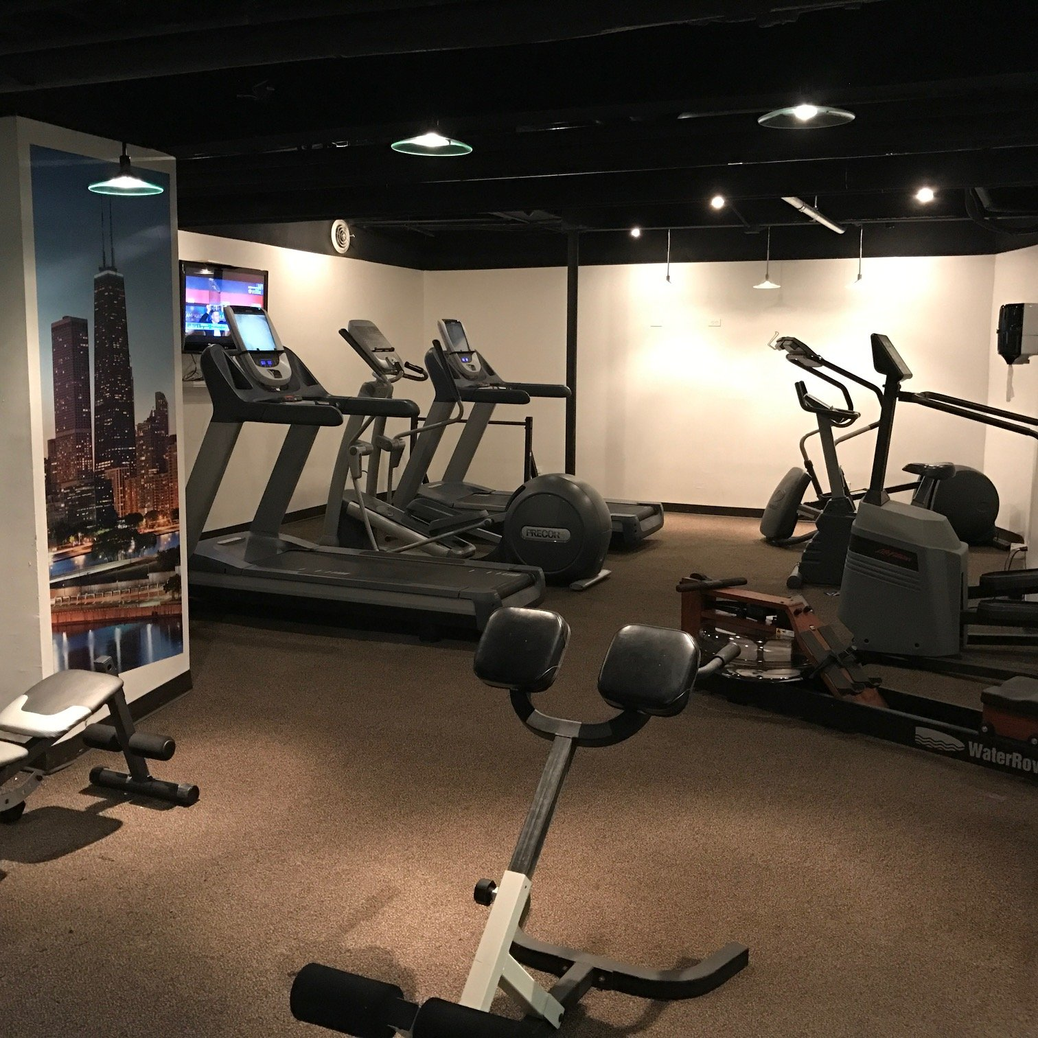Open 24 Hours/ 7 Days a week, cardio and weight equipment and flat screen television!