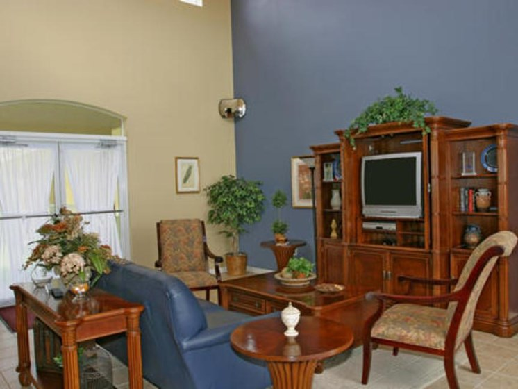 Community room interior with tables, seats, and a TV_Allapattah Gardens Miami, FL