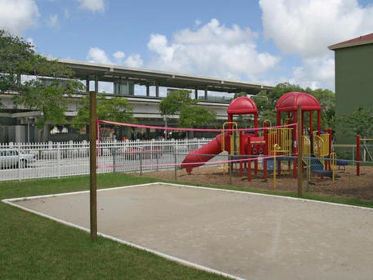Outdoor playground and volleyball court outside_Allapattah Gardens Miami, FL
