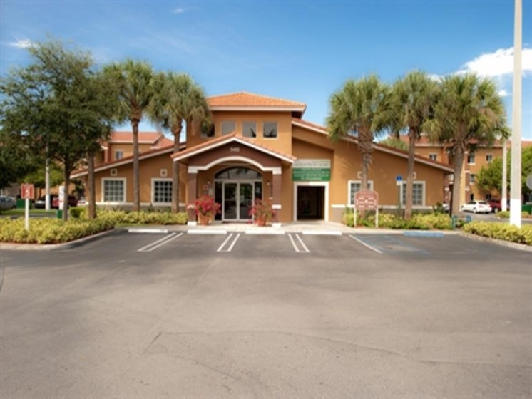 Leasing office exterior and parking lot area_Allapattah Gardens Miami, FL