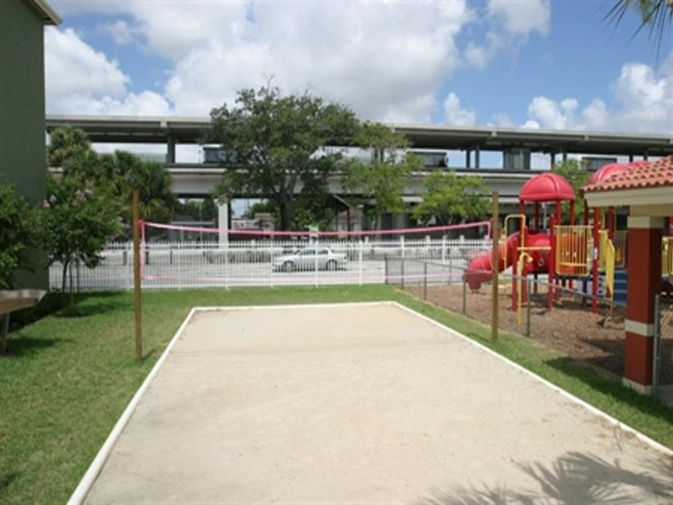 Outdoor playground and Volleyball court outside_ Allapattah Gardens Miami, FL