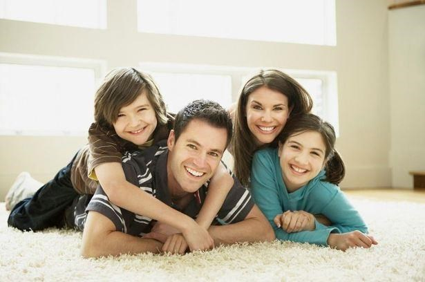 happy family laying down on the carpet inside of aparment_Douglas Pointe Apartments, Carol City FL
