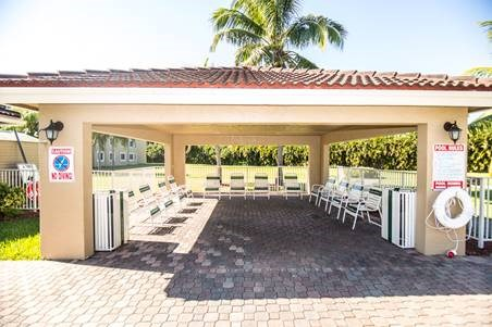 outdoor covered pool area with pool chairs_Westview Gardens Apartments Miami, Florida