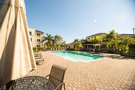 outdoor pool and pool area with tables and chairs_Westview Gardens Apartments Miami, Florida