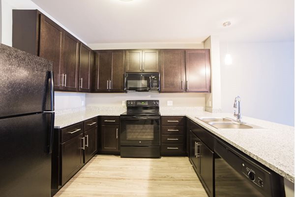 The Flats at Austin Landing Apartments in Miamisburg, OH - Kitchen with Granite Countertops