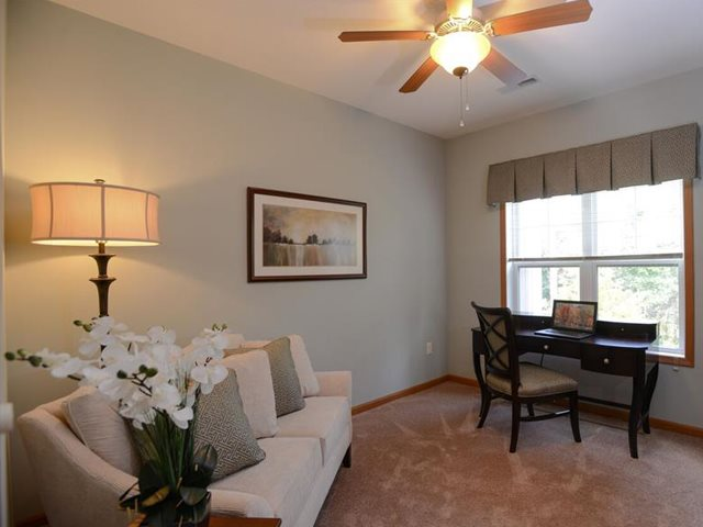 Large Living Rooms With Over Sized Windows at Highlands at Riverwalk Apartments 55+, Wisconsin 53092