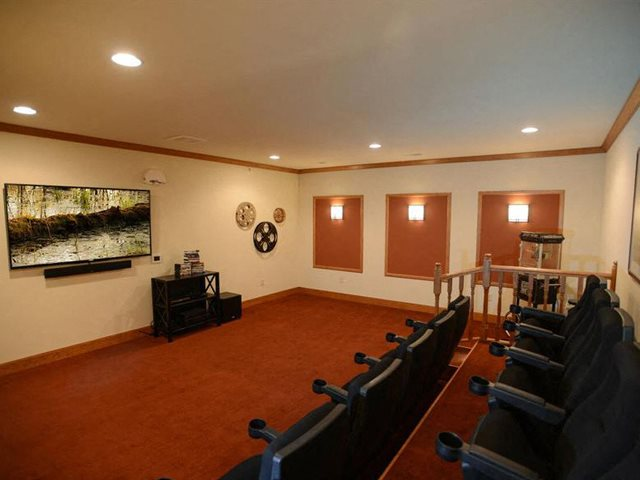 Media Room With Large Screens at Highlands at Riverwalk Apartments 55+, 10954 N Cedarburg Road