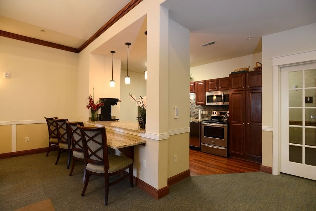 Community Room Kitchen and Breakfast Bar at Highlands at Riverwalk Apartments 55+, Mequon, WI,53092