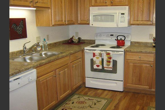 Gourmet Kitchens with Islands, Caesarstone Countertops, and Decorative Backsplash at Highlands at River Crossing Apartments, Winneconne, WI