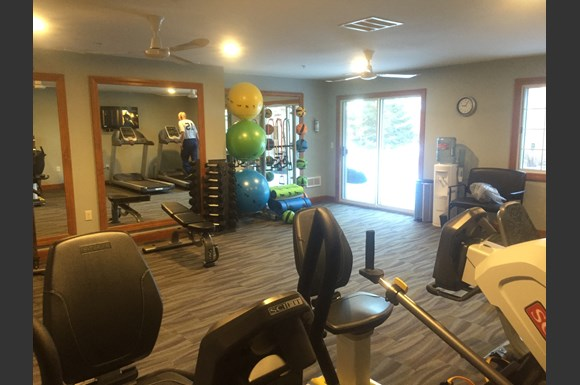 24-Hour Fitness Center at at Wildwood Highlands Apartments & Townhomes 55+, Menomonee Falls, WI