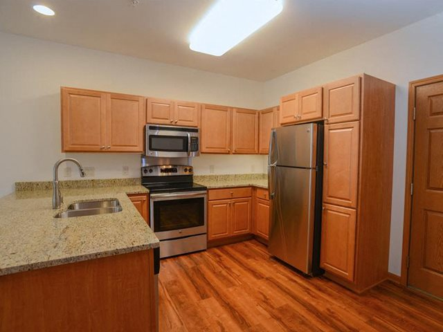 Fully equipped kitchen with Over-the-Range Microwaves at The Highlands at Mahler Park Apartments 55+, Neenah, Wisconsin, 54956