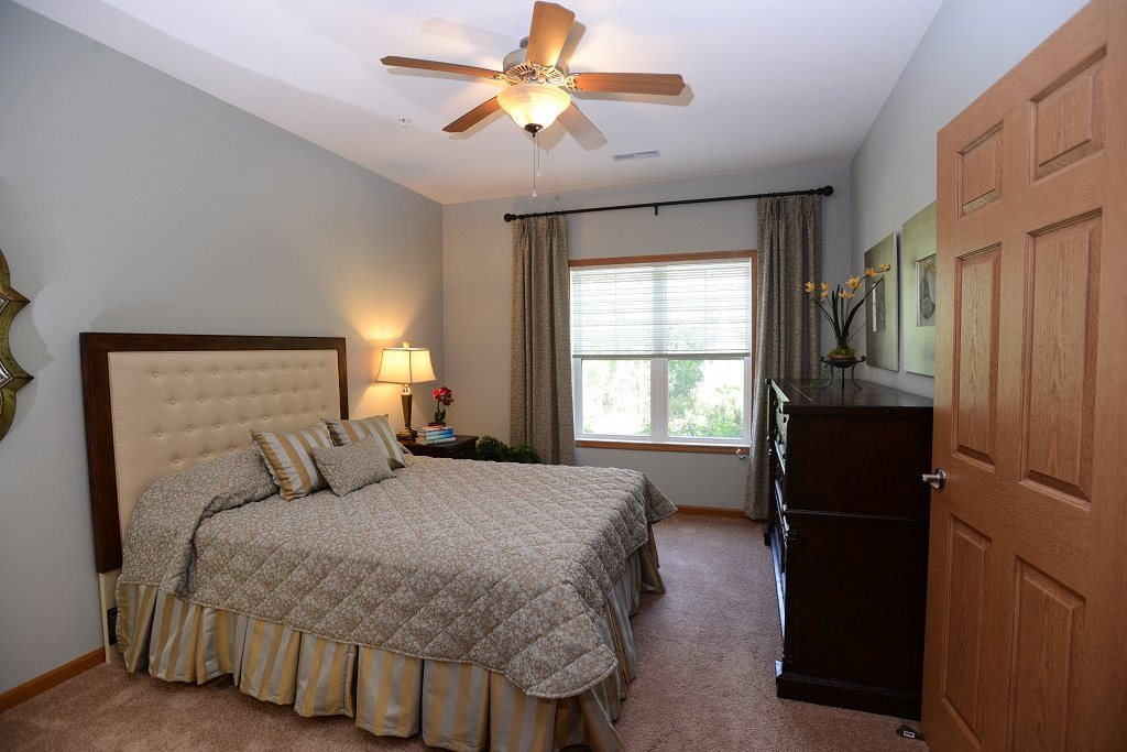 Live in cozy bedrooms With Ceiling Fans at The Highlands at Mahler Park Apartments 55+, Neenah, Wisconsin, 54956