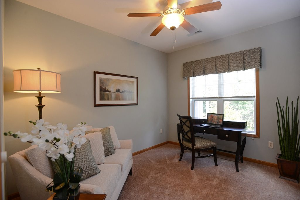 Living Rooms With Wall to Wall Carpeting at The Highlands at Mahler Park Apartments 55+, Neenah, Wisconsin