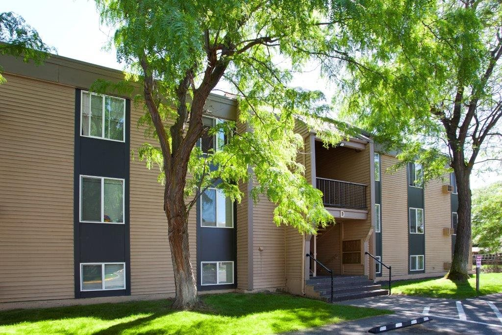 Cedar North Apartments Exterior Building and Trees