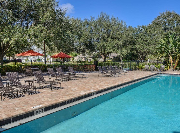 The Savannahs at James Landing Melbourne FL 32935 sun deck with lots of pool furniture