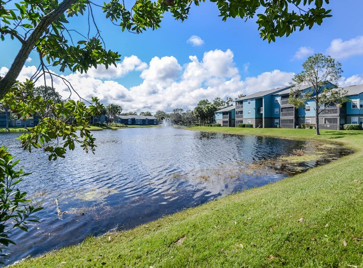 The Savannahs at James Landing Melbourne FL 32935 grassy lake shores near homes
