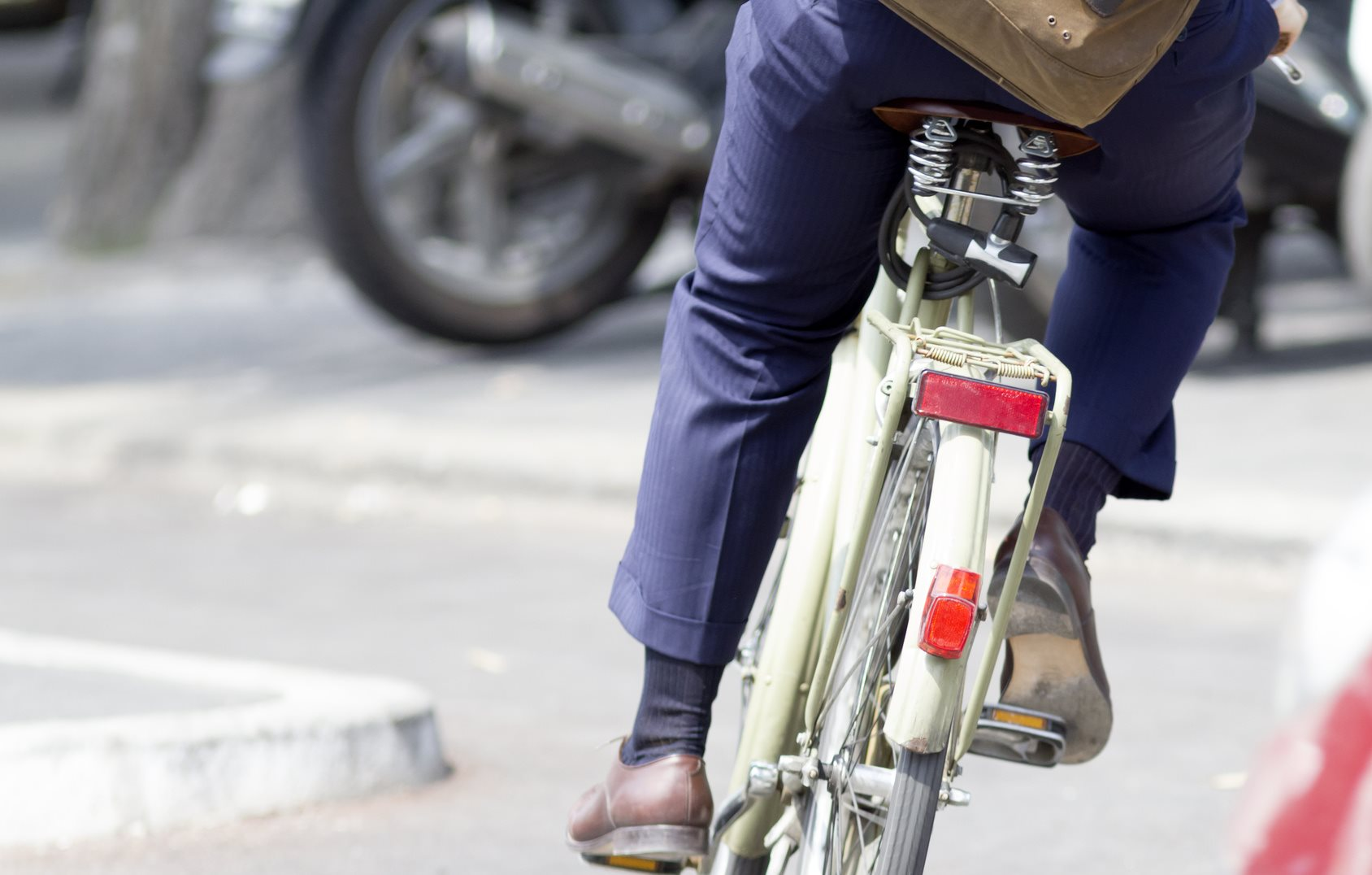 Person In Business Suit Commuting On Bicycle